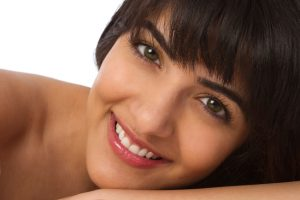 woman smiling thanks to the cosmetic dentist Indpendence relies on Dr. Nakhla